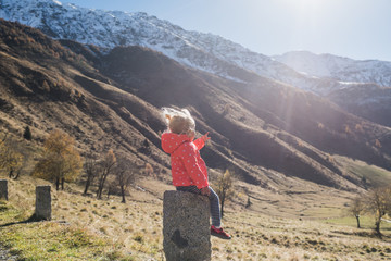 young girl and mountains