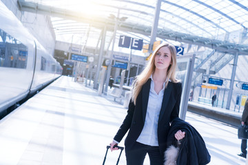 young blonde business woman travel stock photo