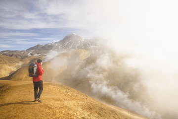 Hiker surrounded by geothermal smoke, Kerlingarfjoll, Iceland