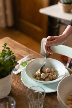 woman hands serving meatballs