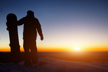 Foto auf Leinwand Braun Snowboard and ski concept with snowboarder on mountain top at sunset time. Space for text