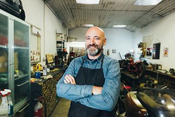 Portrait of mature man, in garage