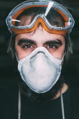 Portrait of male metalworker in dust mask