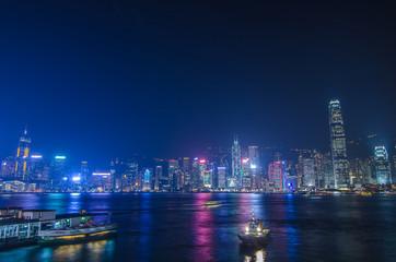 HONG KONG, CHINA - DEC 8, 2016: Hong Kong cityscape waterfront over Victoria harbor, to night on December 8, 2016 in Hong Kong, China