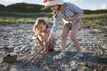 Girls searching for shells on beach, Blowing Rocks Preserve, Jupiter, Florida, USA