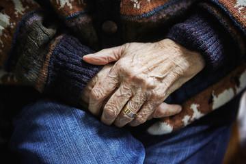 Wrinkled hands of senior person