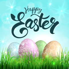 Easter eggs on grass and lettering -  Happy Easter. Vector.