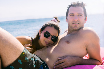 Young couple sunbathing on pier at Burgaz Island, Istanbul, Turkey