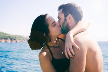 Romantic young couple kissing by sea at Burgaz Island, Istanbul, Turkey