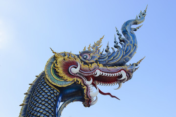 King of Naga in temple of Thailand with blue sky
