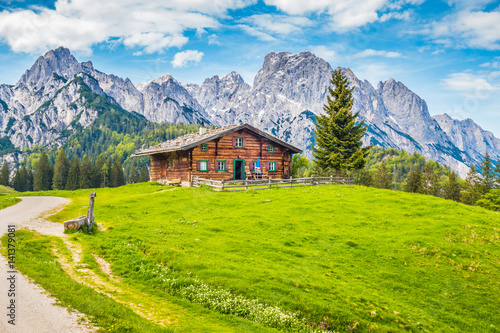 Wall mural Traditional wooden mountain chalet in alpine mountain scenery