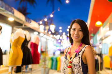 Young Woman shopping at night market in Thailand