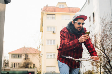 Man listening to the music and riding bicycle