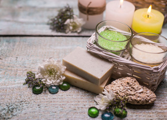spa setting  therapy with flowers, soap, candles   isolated on  wooden background.