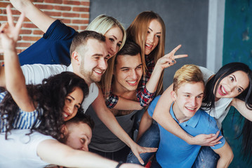 Group beautiful young people doing selfie in a cafe, best friends girls and boys together having fun, posing emotional lifestyle  concept