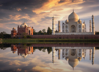 Fototapete - Taj Mahal at sunset as seen from Mehtab Bagh on the banks of the river Yamuna at Agra. Taj Mahal designated as a World Heritage Site is a masterpiece of Indian heritage and architecture.