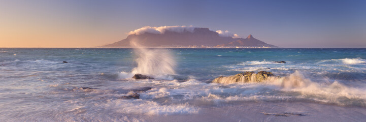 Sunrise over Table Mountain and Cape Town from Blouwbergstrand