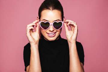 Stylish young woman posing with funky shades Wall mural