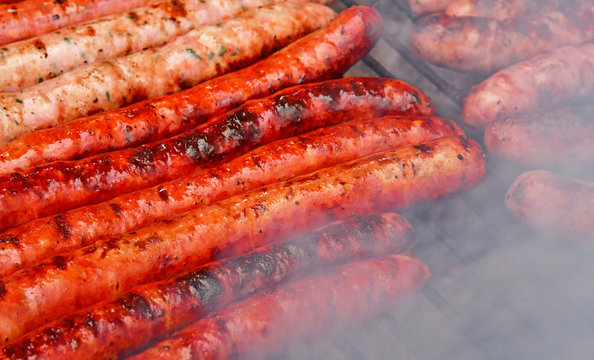 close up of sausages on a barbecue