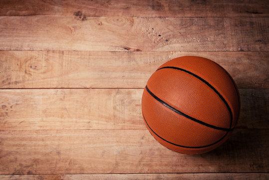 A basketball on a wood