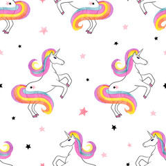 Seamless rainbow unicorns pattern. Vector magic background.