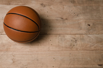 A basketball on a wood