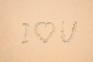 I love you drawing on the beach.