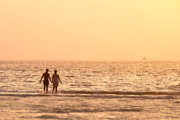 Silhouette of Romantic couple on the beach, Phuket, Thailand.