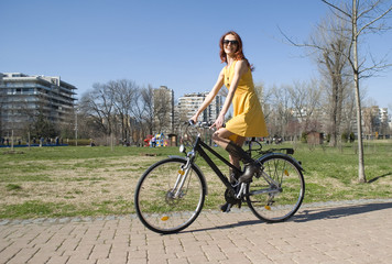 Attractive woman cycling