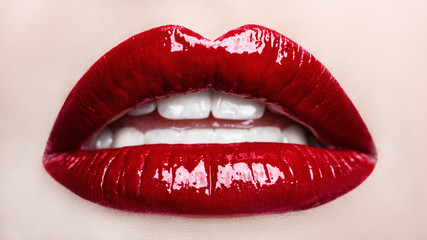 Passionate red lips. Opened mouth. Beautiful makeup close up. Macro photography, small depth of field