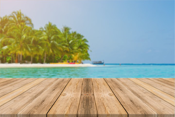 Wooden board empty table in front of blue sea & sky background. Perspective wood floor over sea and sky - can be used for display or montage your products. beach & summer concepts.