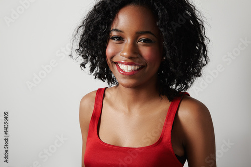 Black Woman In Red Dress With Bright Red Lips And Curly Hair Stock