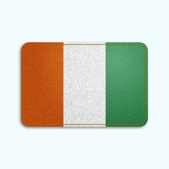 National flag of Ivory coast with denim texture and orange seam. Realistic image of a tissue made in vector illustration.