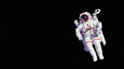 astronaut in an EMU (Extravehicular Mobility Unit) floating in deep space - elements of this image are furnished by NASA