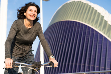 Cheerful woman riding a bike
