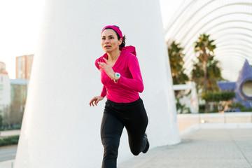 Adult woman running hard