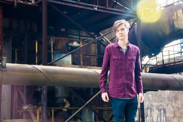 Teen boy in industrial area
