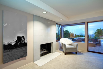 Lovely bedroom design with fireplace and exit to patio