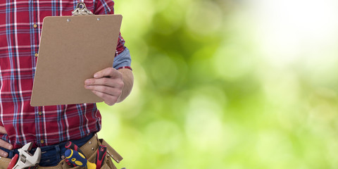 builder with a folder of documents, building repairs and maintenance