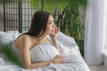 Female dreaming in her bedroom