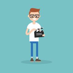 Camera crew: young assistant holding a clapperboard / editable flat vector cartoon illustration, clip art