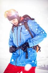 Skier tightening his backpack belt