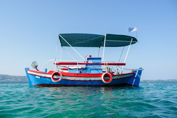Little blue and red fishing boat in Ammouliani, Chalkidiki, Greece