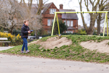 School boy with quadrocopter inthe park