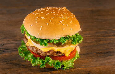 Appetizing homemade cheeseburger with beef patty tomato, cheese,