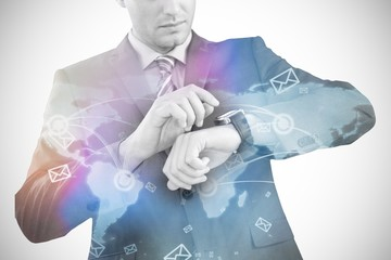 Composite image of businessman checking smart watch 3d
