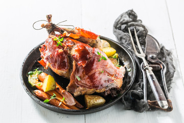 Fresh pheasant with bacon and vegetables and spices