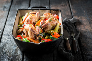 Grilled quails with vegetables and spices in casserole