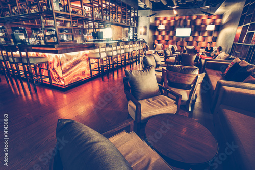 A modern restaurant cafe interior with chair, table, sofa, lighting ...