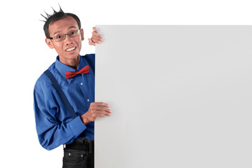 Young asian funny man standing behind blank board for copyspace